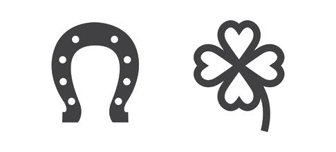 Hoefijzer en vierbladige symbolen